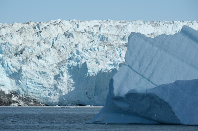 An iceberg drifts near the 200 meter tall face of the Eqip Sermia glacier, also called the Eqi glacier, during unseasonably warm weather at Eqip Sermia, Greenland. (Photo: Sean Gallup/Getty Images)
