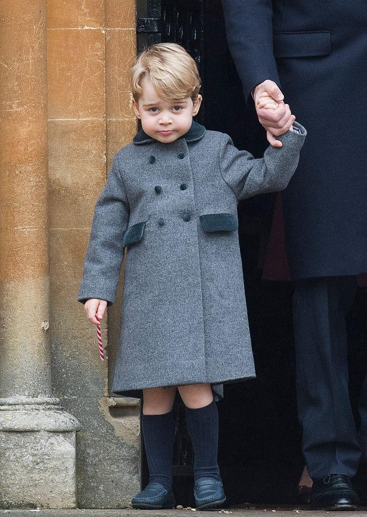 <p>Prince George certainly got into the festive spirit as he enjoyed a candy cane during a church ceremony with his family last Christmas. And although his £120 coat sold out online instantaneously, his navy 'Barnie' loafers are still up for grabs. <em>[Photo: Getty]</em> </p>