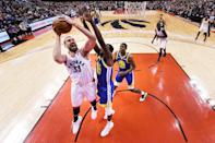 Marc Gasol #33 of the Toronto Raptors attempts a shot against Draymond Green #23 of the Golden State Warriors in the first quarter at Scotiabank Arena on May 30, 2019 in Toronto, Canada. (Photo by Kyle Terada - Pool/Getty Images)