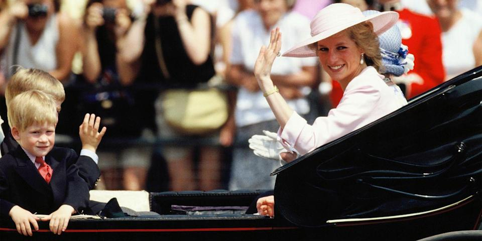 <p>Waving to the crowds in an open carriage for Trooping the Colour Procession.</p>