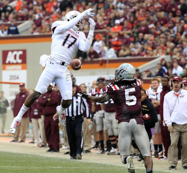 Maryland defensive back Isaac Goins (17) breaks up a pass intended for Virginia Tech wide receiver Joshua Stanford (5) during the first half of an NCAA college football game in Blacksburg, Va., Saturday, Nov. 16, 2013. (AP Photo/Steve Helber)