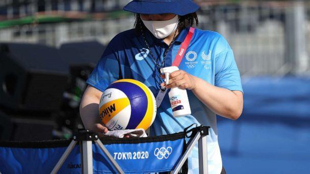 PHOTO: A worker sanitizes beach volleyballs during training at Shiokaze Park ahead of the Tokyo 2020 Olympic Games on July 20, 2021, in Tokyo. (Sean M. Haffey/Getty Images)