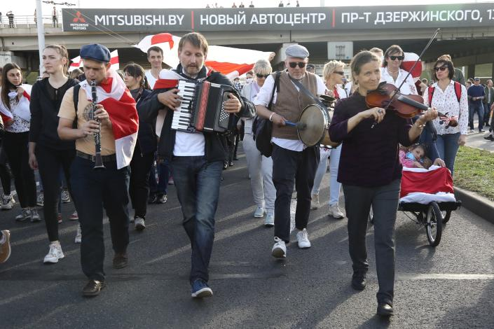 A group of musicians attend a Belarusian opposition supporters' rally protesting the official presidential election results in Minsk, Belarus, Sunday, Sept. 13, 2020. Protests calling for the Belarusian president's resignation have broken out daily since the Aug. 9 presidential election that officials say handed him a sixth term in office. (TUT.by via AP)