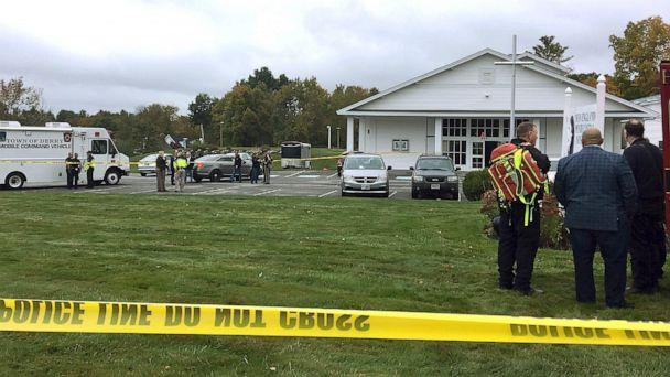 PHOTO: Police stand outside the New England Pentecostal Church after reports of a shooting on Saturday, Oct. 12, 2019, in Pelham, N.H. (Siobhan Lopez/AP)