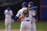 New York Mets' Pete Alonso, right, hugs relief pitcher Edwin Diaz after a baseball game against the Washington Nationals at Citi Field, Sunday, April 25, 2021, in New York. (AP Photo/Seth Wenig)