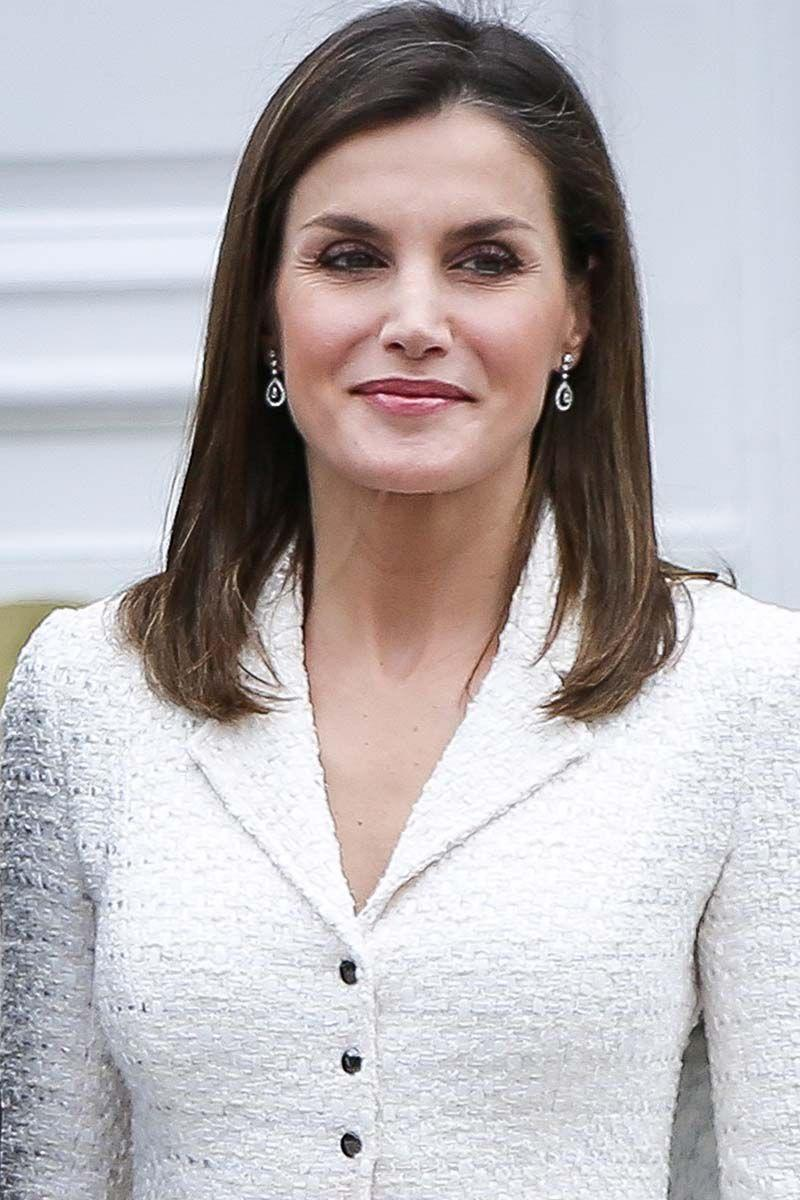 <p>Queen Letizia of Spain topped of her crisp, white suit with pin straight locks.</p>