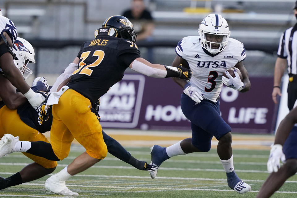 UTSA running back Sincere McCormick (3) runs past Southern Mississippi linebacker Hayes Maples (32) for a first down during the second half of an NCAA college football game, Saturday, Nov. 21, 2020, in Hattiesburg, Miss. UTSA won 23-20. (AP Photo/Rogelio V. Solis)