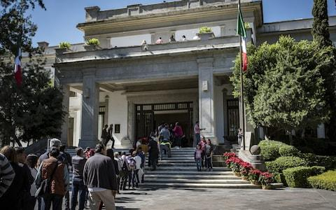 Visitors wait in line to enter the Miguel Aleman house at Los Pinos, the former official residence of the President of Mexico, in Mexico City, - Credit: Bloomberg