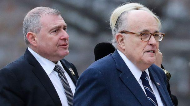 PHOTO: Rudy Giuliani, right, and Soviet born businessman who served as Giuliani's fixer in Ukraine, Lev Parnas, left, arrive for the funeral of former president George H.W. Bush at the National Cathedral in Washington on Dec. 5, 2018. (Alex Edelman/AFP via Getty Images)