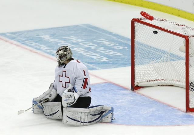 Switzerland's Melvin Nyffeler lets in a goal by Canada's Derrick Pouliot, not pictured, during the third period of their IIHF World Junior Championship ice hockey game in Malmo, Sweden, January 2, 2014. REUTERS/Alexander Demianchuk (SWEDEN - Tags: SPORT ICE HOCKEY)