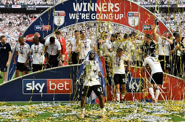 "Soccer Football - Championship Play-Off Final - Fulham vs Aston Villa - Wembley Stadium, London, Britain - May 26, 2018 Fulham's Aboubakar Kamara and team mates celebrate promotion to the Premier League with the trophy Action Images via Reuters/Tony O'Brien EDITORIAL USE ONLY. No use with unauthorized audio, video, data, fixture lists, club/league logos or ""live"" services. Online in-match use limited to 75 images, no video emulation. No use in betting, games or single club/league/player publications. Please contact your account representative for further details."