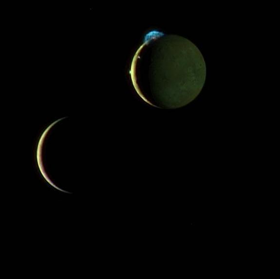 This is a composite image of Jupiter's volcanic moon Io and Europa taken during a March 2, 2007 flyby by NASA's New Horizons spacecraft. Here Io (top) steals the show with its beautiful display of volcanic activity. Three volcanic plumes are vi