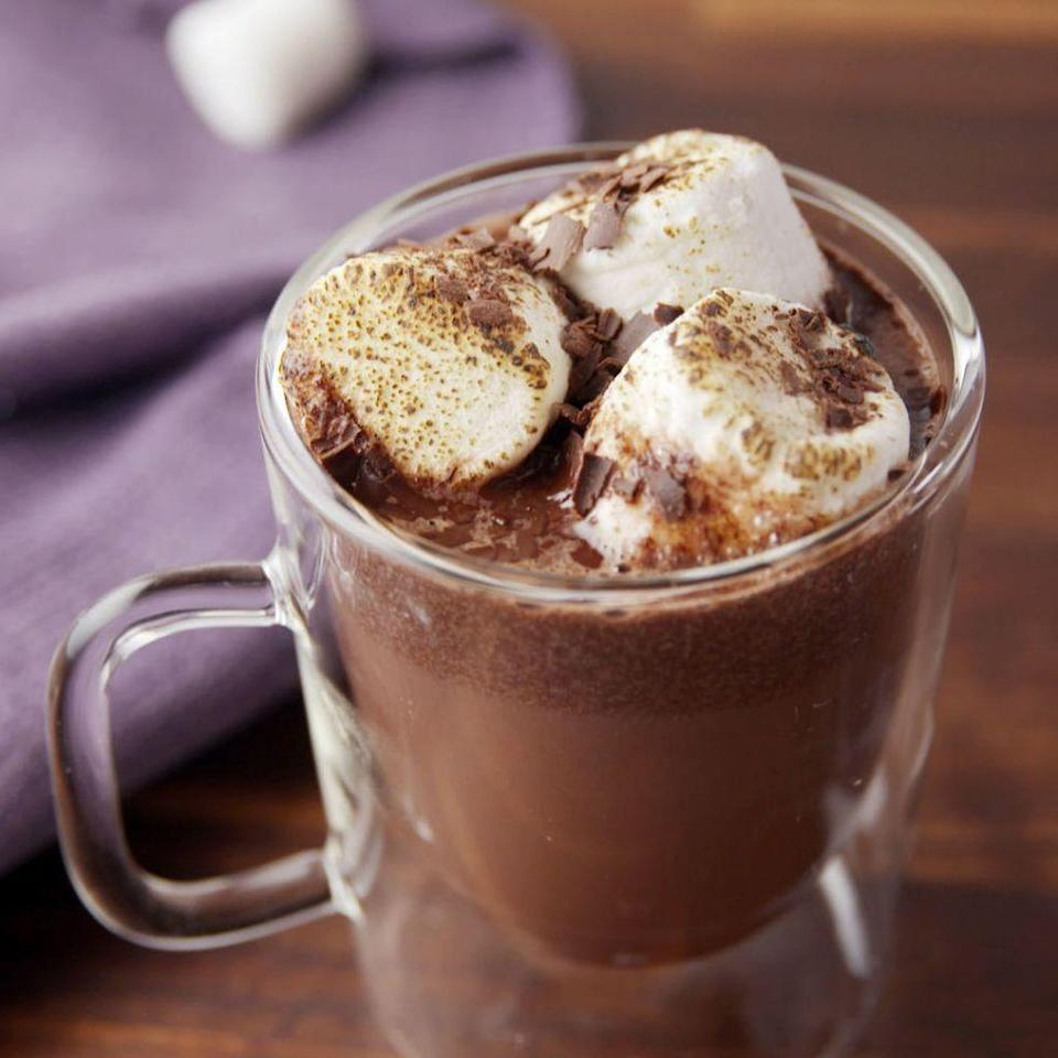"""<p>Let your slow cooker prepare your party drinks. </p><p>Get the <a href=""""https://www.delish.com/uk/cocktails-drinks/a29261611/crock-pot-red-wine-hot-cocoa-recipe/"""" rel=""""nofollow noopener"""" target=""""_blank"""" data-ylk=""""slk:Slow Cooker Red Wine Hot Chocolate"""" class=""""link rapid-noclick-resp"""">Slow Cooker Red Wine Hot Chocolate</a> recipe.</p>"""