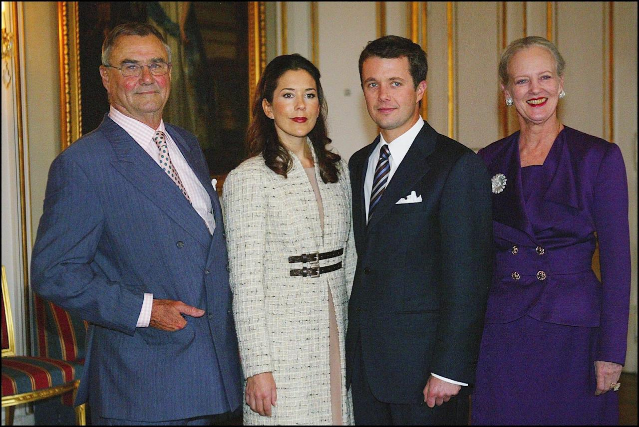 <p>Beginning what would be a long and supportive relationship, Prince Henrik was by Mary's side when she announced her engagement to Prince Frederik in October 2003.</p><br/>