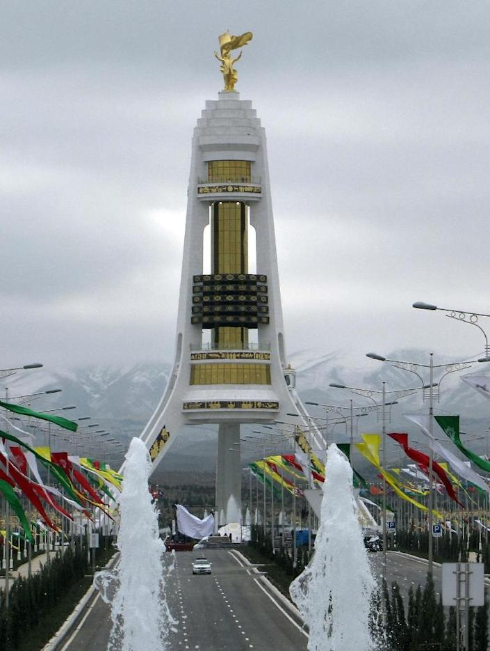 A golden statue of Saparmurat Niyazov on the top of a new monument in Ashgabat in 2011 (AFP Photo/Igor Sasin)