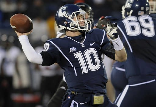 Connecticut quarterback Chandler Whitmer (10) throws during the first half of an NCAA college football game against Cincinnati at Rentschler Field in East Hartford, Conn., Saturday, Dec. 1, 2012. (AP Photo/Jessica Hill)