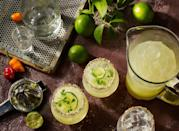 """<p><a href=""""https://www.elle.com/uk/life-and-culture/travel/g30495431/best-cocktail-bars-london/"""" rel=""""nofollow noopener"""" target=""""_blank"""" data-ylk=""""slk:Cocktails"""" class=""""link rapid-noclick-resp"""">Cocktails</a> never taste as good at home but that's all about to change. Fill your fridge with cocktail ingredients and attempt each other's favourites - it will be like having your own personal bar service at home.<br></p>"""