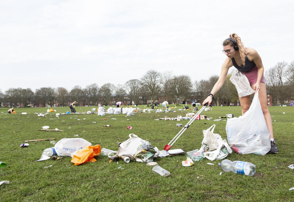 Volunteers, council workers and police help clean up rubbish in Woodhouse Moor, Leeds. (SWNS)