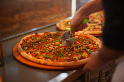 The new Mt. Diablo pizza at Pizza My Heart with Beyond Meat hot Italian sausage, Miyoko's vegan pizza cheese, pizza sauce, garlic, fresh mushrooms, pickled peppers and fresh parsley