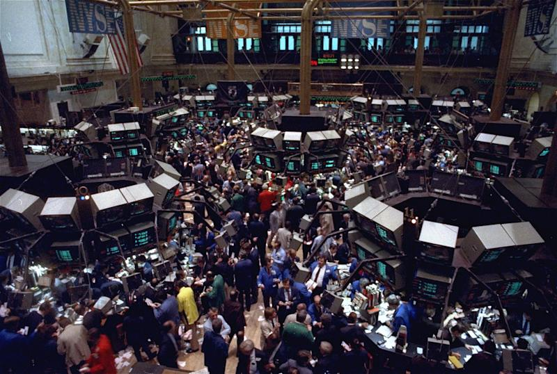 The New York Stock Exchange trading floor is jammed with traders in this October 19, 1987 file photo as stocks plunged in the biggest one-day selloff in history. (AP Photo/Peter Morgan)