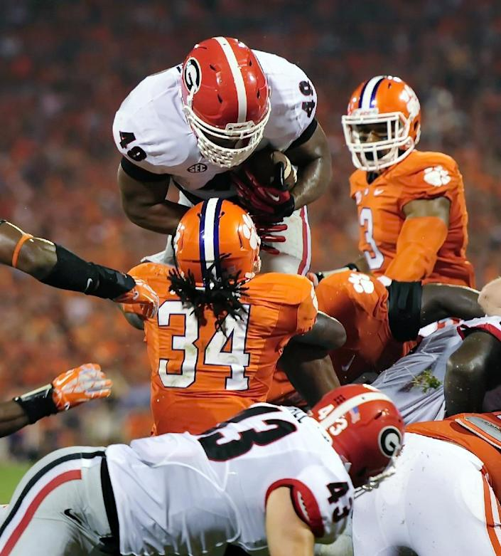 Georgia fullback Quayvon Hicks is stopped at the goal line by Clemson's Quandon Christian during the second half of an NCAA college football game, Saturday, Aug. 31, 2013, at Memorial Stadium in Clemson, S.C. (AP Photo/ Richard Shiro)
