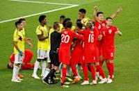 <p>From the resulting free kick Colombia Wilmar Barrios is yellow carded for headbutting Jordan Henderson while Harry Maguire gestures for VAR </p>