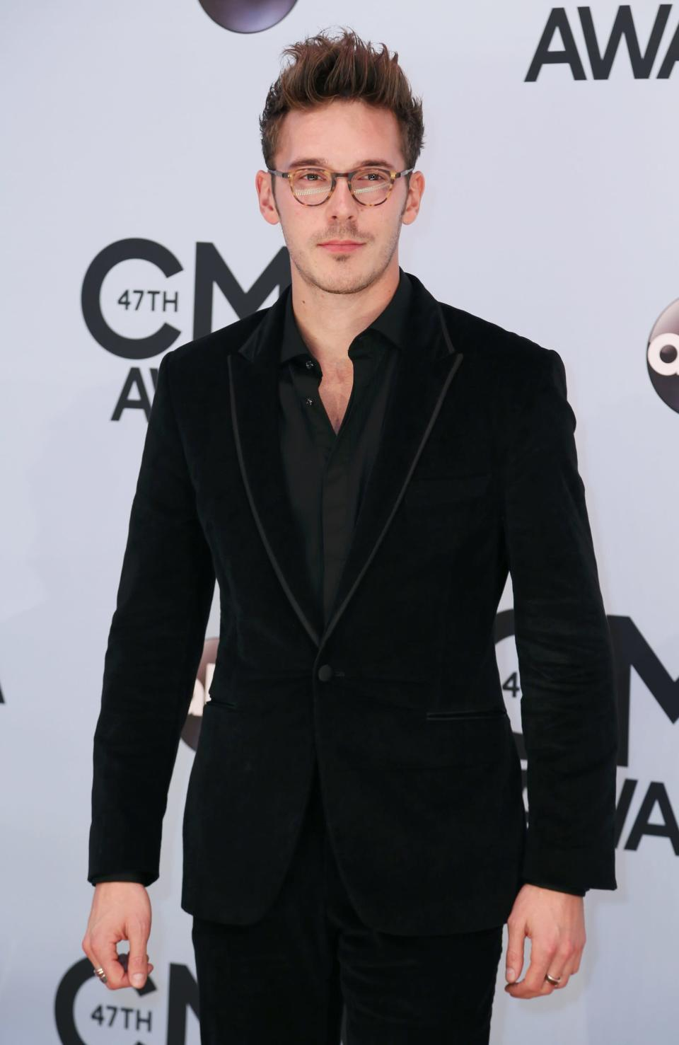 Actor Sam Palladio arrives at the 47th Country Music Association Awards in Nashville, Tennessee November 6, 2013. REUTERS/Eric Henderson (UNITED STATES - Tags: ENTERTAINMENT)