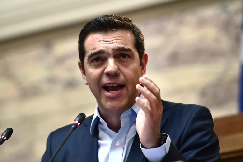 Prime minister Alexis Tsipras' enactment of pension cuts and lower tax breaks has sparked a 24-hour strike in Greece (AFP Photo/LOUISA GOULIAMAKI)