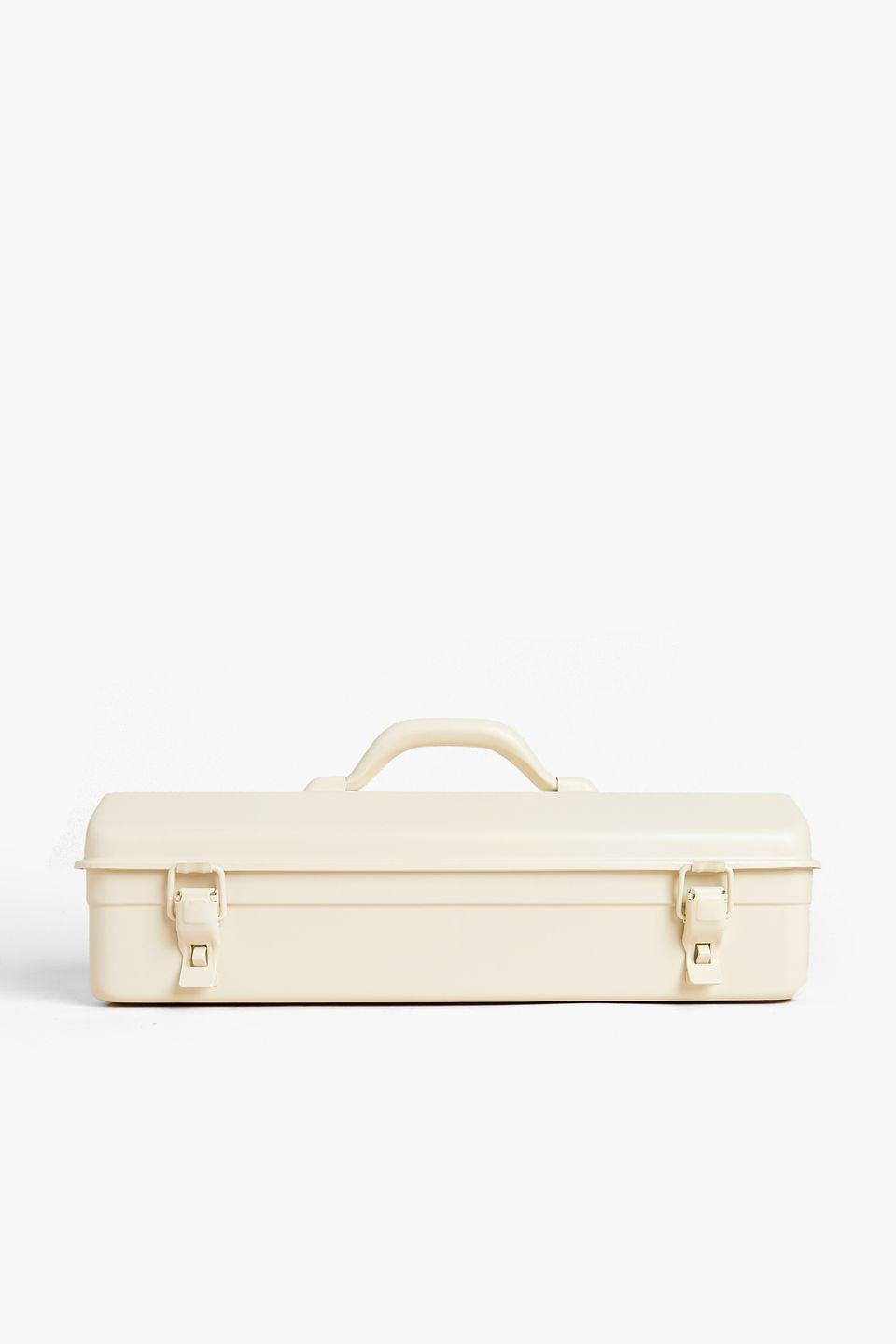 <p>Made of cream lacquered galvanised iron, this sleek, minimal tool box features a carry handle and double hook airtight fastening.</p>