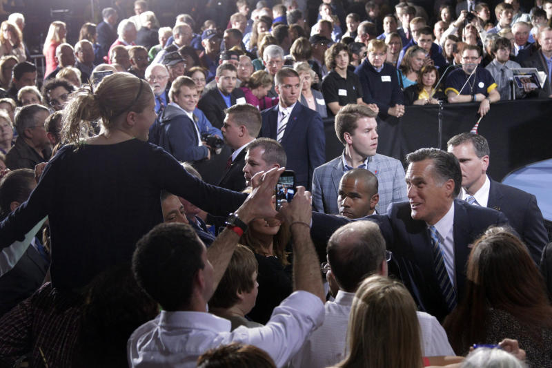 FILE - In this April 24, 2012 file photo, Republican presidential candidate, former Massachusetts Gov. Mitt Romney, right, greets supporters at an election night rally in Manchester, N.H. The world's two biggest economies are entering the final stages of political campaigns to pick their national leaders. While American candidates wage loud, rah-rah campaigns with a clear timetable as they head toward the Nov. 6 presidential election, China hasn't even announced the date for this fall's Communist Party congress that will appoint the next top leader to replace outgoing Hu Jintao - a post widely expected to go to Vice President Xi Jinping. (AP Photo/Jae C. Hong, File)