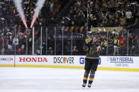 Vegas Golden Knights center Mattias Janmark thanks fans after the Golden Knights defeated the Minnesota Wild in Game 7 of an NHL hockey Stanley Cup first-round playoff series Friday, May 28, 2021, in Las Vegas. Janmark scored a hat trick. (AP Photo/Joe Buglewicz)