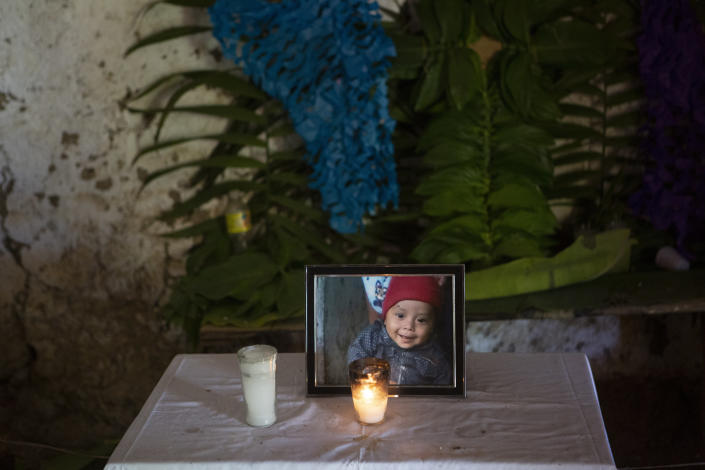 In this May 30, 2019 photo, a portrait of Wilmer Josué Ramírez Vásquez, a 2-year-old Guatemalan boy who died in U.S. custody on May 14, stands on an altar at his grandmother's home in Tituque village, in the Olopa municipality of eastern Guatemala. Wilmer and his mother Hilda left home in March and took 22 days to make the journey to the U.S. during when he became ill in Mexico and crossed into the United States with a high fever and difficulty breathing. Diagnosed with pneumonia at a children's hospital, Wilmer died about a month later. (AP Photo/Moises Castillo)