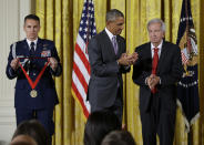 """FILE - President Barack Obama prepares to award the 2014 National Humanities Medal to novelist, essayist, and screenwriter Larry McMurtry during a ceremony at the White House in Washington, on Sept. 10, 2015. McMurtry has died at the age of 84. His death was confirmed Friday, March 26, 2021, by a spokesman for his publisher Liveright. Several of McMurtry's books became feature films, including the Oscar-winning films """"The Last Picture Show"""" and """"Terms of Endearment."""" He also co-wrote the Oscar-winning screenplay for """"Brokeback Mountain."""" (AP Photo/Manuel Balce Ceneta, File)"""