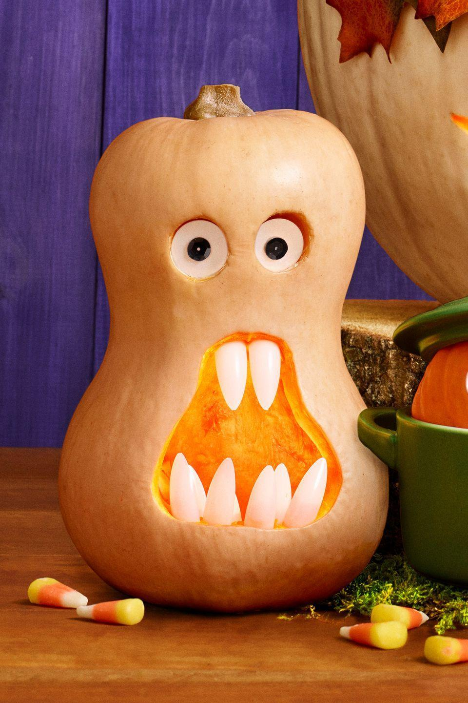 "<p>This surprised fella will look oh-so adorable on your stoop. Carve circle eyes and big mouth in any size squash. Push artificial nails into edge of mouth for teeth. For eyes, glue black sequin pupils to at seashell coins; push into place.</p><p><strong>What You'll Need: </strong><a href=""https://www.amazon.com/Makartt-500pcs-Natural-Acrylic-Ballerina/dp/B06XRYT918/?tag=syn-yahoo-20&ascsubtag=%5Bartid%7C10070.g.950%5Bsrc%7Cyahoo-us"" rel=""nofollow noopener"" target=""_blank"" data-ylk=""slk:Artificial nails"" class=""link rapid-noclick-resp"">Artificial nails</a> ($8 for 500, Amazon)</p>"