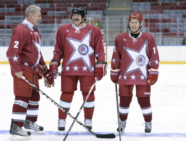Russian President Vladimir Putin (R), his Belarussian counterpart Alexander Lukashenko (C) and retired Russian ice hockey player Vyacheslav Fetisov take part in a friendly ice hockey match in the Bolshoi Ice Palace near Sochi January 4, 2014. REUTERS/Alexei Nikolskiy/RIA Novosti/Kremlin (RUSSIA - Tags: POLITICS SPORT OLYMPICS ICE HOCKEY) ATTENTION EDITORS - THIS IMAGE HAS BEEN SUPPLIED BY A THIRD PARTY. IT IS DISTRIBUTED, EXACTLY AS RECEIVED BY REUTERS, AS A SERVICE TO CLIENTS