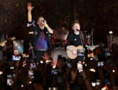 <p>Ed Sheeran performs with Coldplay's Chris Martin, to celebrate the band's forthcoming <em>Music of the Spheres</em> album, at O2 Shepherd's Bush Empire on Oct. 12 in London.</p>
