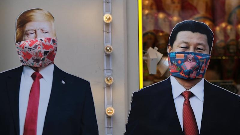 Cardboard cutouts of U.S. President Donald Trump and Chinese President Xi Jinping, with protective masks widely used as a preventive measure against coronavirus disease (COVID-19), near a gift shop in Moscow, Russia