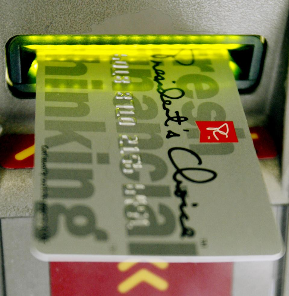 A PC Financial (owned by grocer Loblaws) banking card is inserted into a bank machine in Toronto March 5, 2007.  PC Financial does not charge customers service charges for bank machine transactions at their in-house or CIBC banking machines. Canadian Finance Minister Jim Flaherty is in Toronto on Monday talking to banking executives about excessive fees charged on bank machine transactions.     REUTERS/J.P. Moczulski (CANADA)