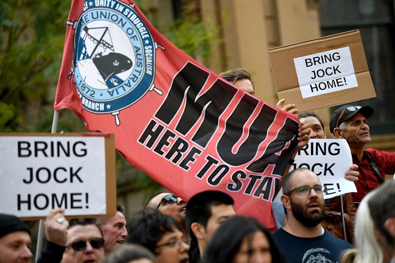 Supporters are seen holding placards during a rally to free Jock Palfreeman at Sydney Town Hall.