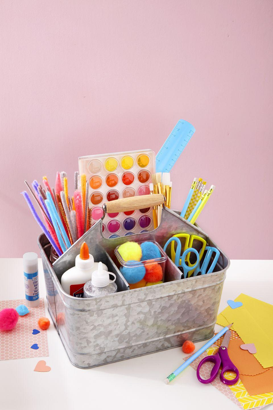 """<p>Make doing homework and school projects easier by keeping all your supplies in a sectioned caddy that can move from room to room and also be easily stored when not in use. Keep it bare, or dress it up like organizing guru <a href=""""http://www.iheartorganizing.com/2011/06/iheart-organized-art-caddy.html"""" rel=""""nofollow noopener"""" target=""""_blank"""" data-ylk=""""slk:Jen Jones"""" class=""""link rapid-noclick-resp"""">Jen Jones</a>! </p>"""