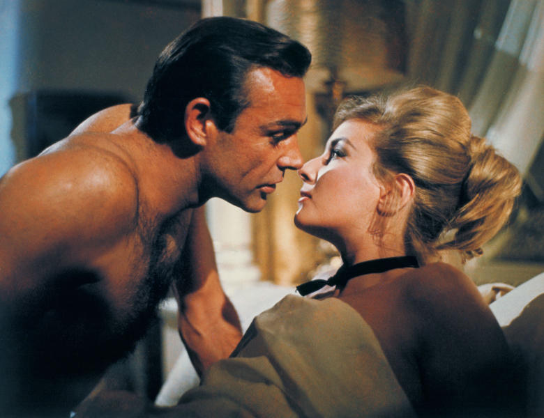 """This undated publicity photo provided by United Artists and Danjaq, LLC shows Sean Connery, left, as James Bond in a scene from the 1963 film, """"From Russia With Love."""" Connery, a relatively unknown Scottish actor and former bodybuilder, was cast in the hit movie as Bond. The film is included in the MGM and 20th Century Fox Home Entertainment Blu-Ray """"Bond 50"""" anniversary set. (AP Photo/United Artists and Danjaq, LLC)"""