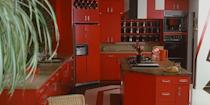 <p>Pine wood countertops with bright bold cabinets will instantly make you feel like you've stepped onto the set of a '70s sitcom. </p>