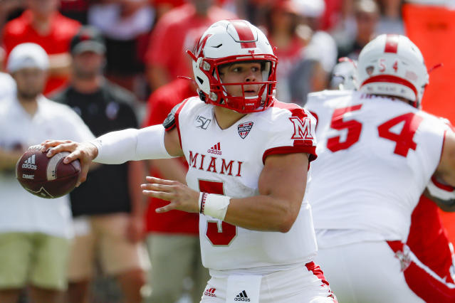 FILE - In this Sept. 14, 2019, file photo, Miami of Ohio quarterback Brett Gabbert throws a pass during the first half of the team's NCAA college football game against Cincinnati in Cincinnati. Miami faces Central Michigan on Saturday in the Mid-American Conference championship game Saturday, Gabbert has thrown for 1,967 yards as a freshman this season. (AP Photo/John Minchillo, File)