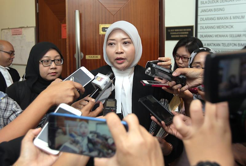 Deputy Public Prosecutor Ainul Wardah Shahidan speaks to reporters outside the High Court in Ipoh November 19, 2019. — Picture by Farhan Najib