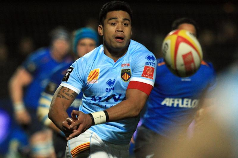 Perpignan's Tongan center Lifeimi Mafi passes the ball during the French Top 14 rugby union match between Perpignan and Bayonne in Perpignan on January 4, 2014