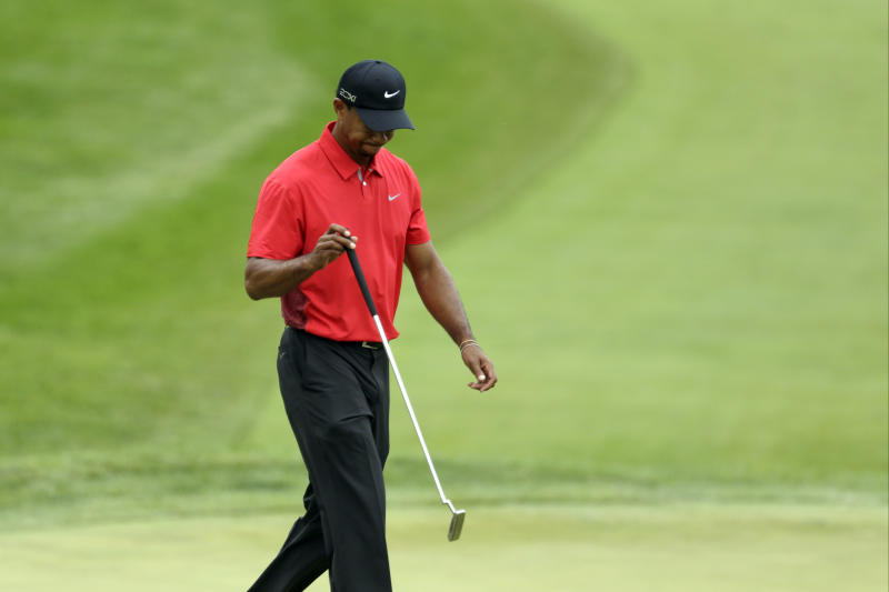 Tiger Woods reacts to a missed putt on the fourth hole during the fourth round of the U.S. Open golf tournament at Merion Golf Club, Sunday, June 16, 2013, in Ardmore, Pa. (AP Photo/Gene J. Puskar)