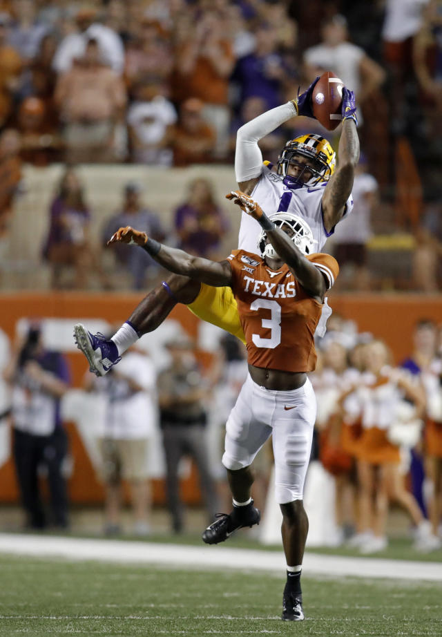 LSU Tigers wide receiver Ja'Marr Chase #1, catches a pass over Texas Longhorns defensive back Jalen Green #3, Saturday Sept. 7, 2019 at Darrell K Royal-Texas Memorial Stadium in Austin, Tx. LSU won 45-38. ( Photo by Edward A. Ornelas )