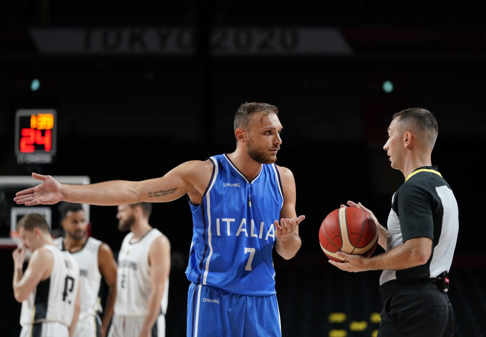 Italy's Stefano Tonut (7) questions a foul call during men's basketball preliminary round game against Germany at the 2020 Summer Olympics, Sunday, July 25, 2021, in Saitama, Japan. (AP Photo/Charlie Neibergall)