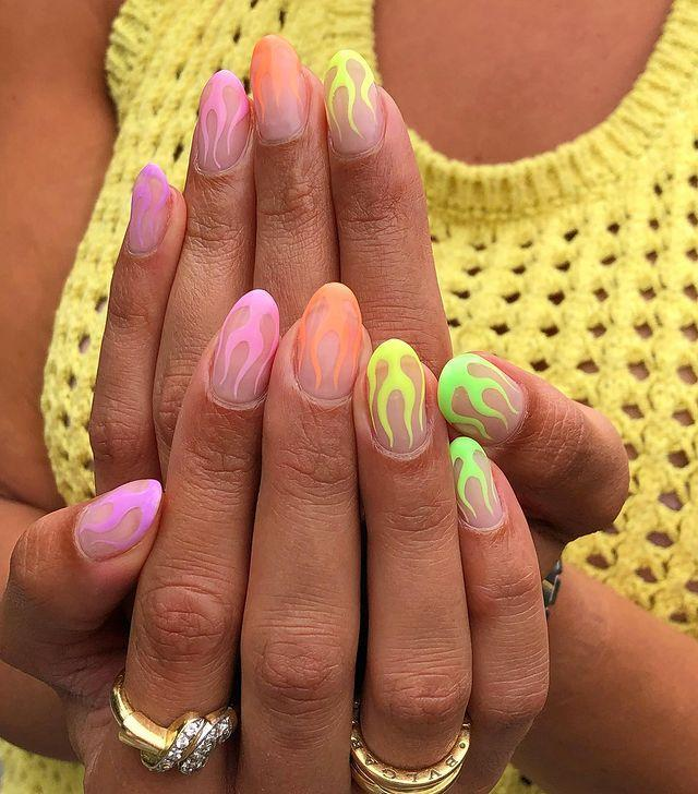 """<p>Pastel neons combine our two favourite trends, add in some flames and we're taking this picture straight to our nail artist.</p><p><a href=""""https://www.instagram.com/p/CEGwYjIJNMy/"""" rel=""""nofollow noopener"""" target=""""_blank"""" data-ylk=""""slk:See the original post on Instagram"""" class=""""link rapid-noclick-resp"""">See the original post on Instagram</a></p>"""