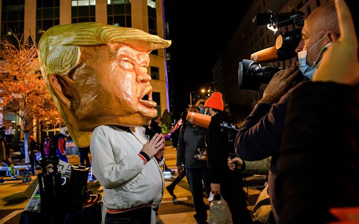An anti-Trump protester on Black Lives Matter Plaza in DC - REX
